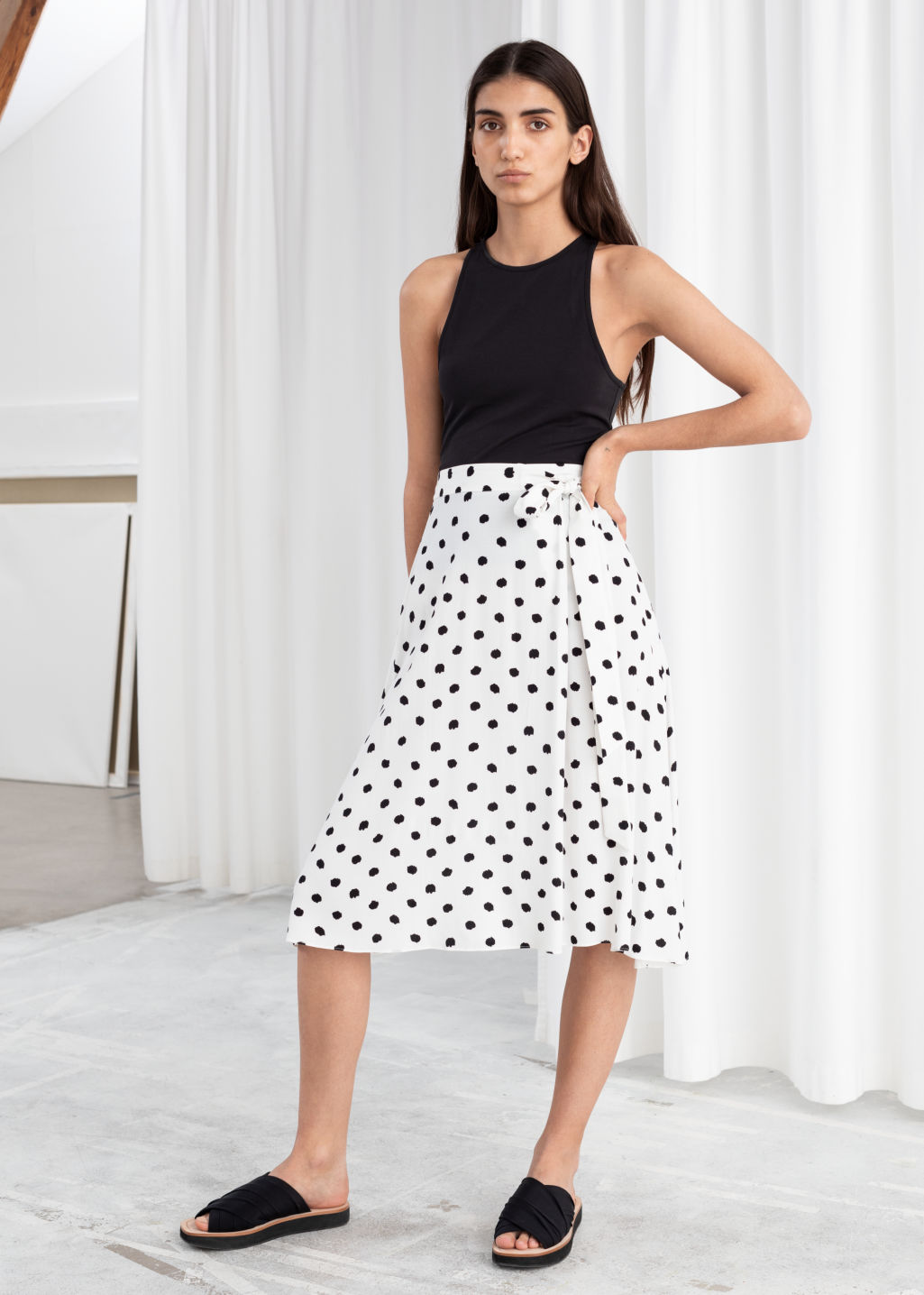 Model front image of Stories belted midi skirt in white