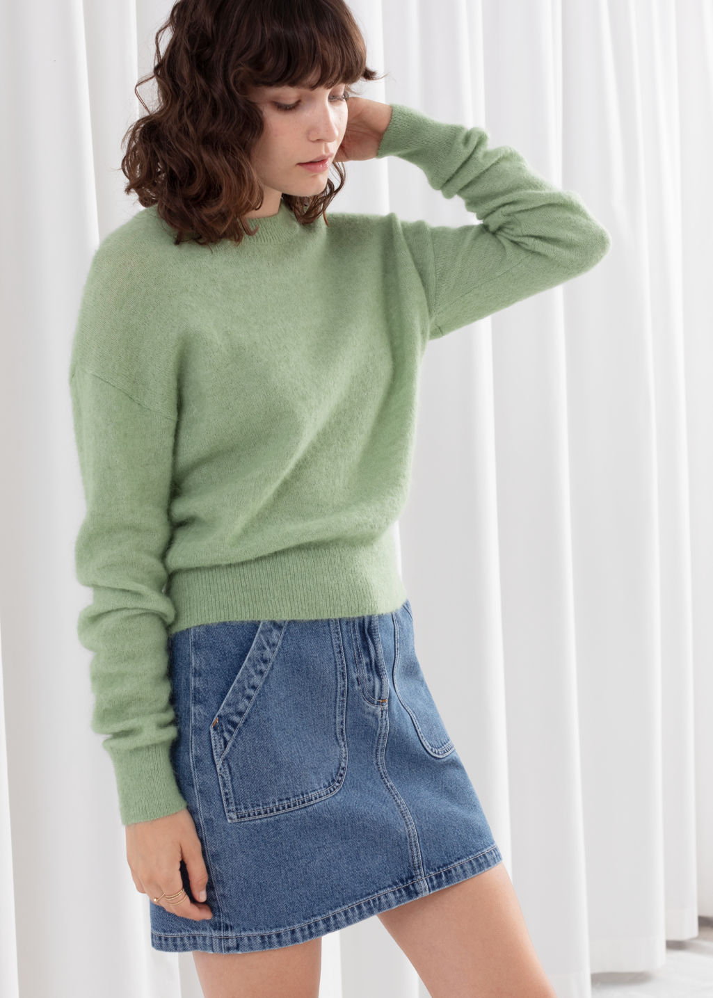 Model front image of Stories fuzzy sweater in green
