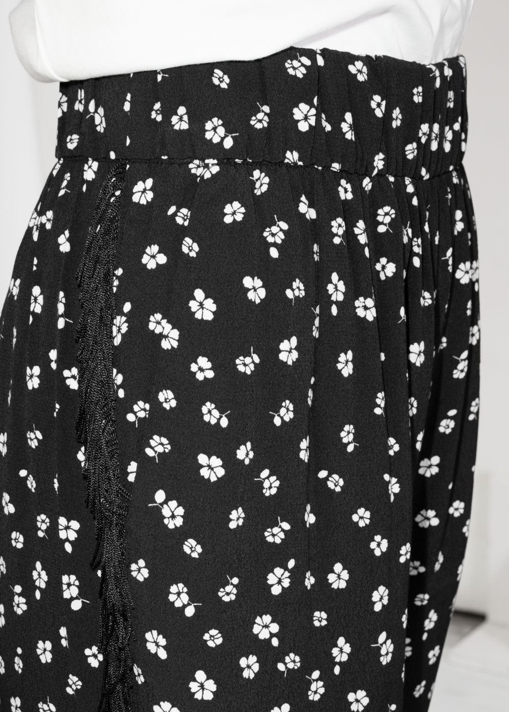 Model back image of Stories floral fringe trousers in black