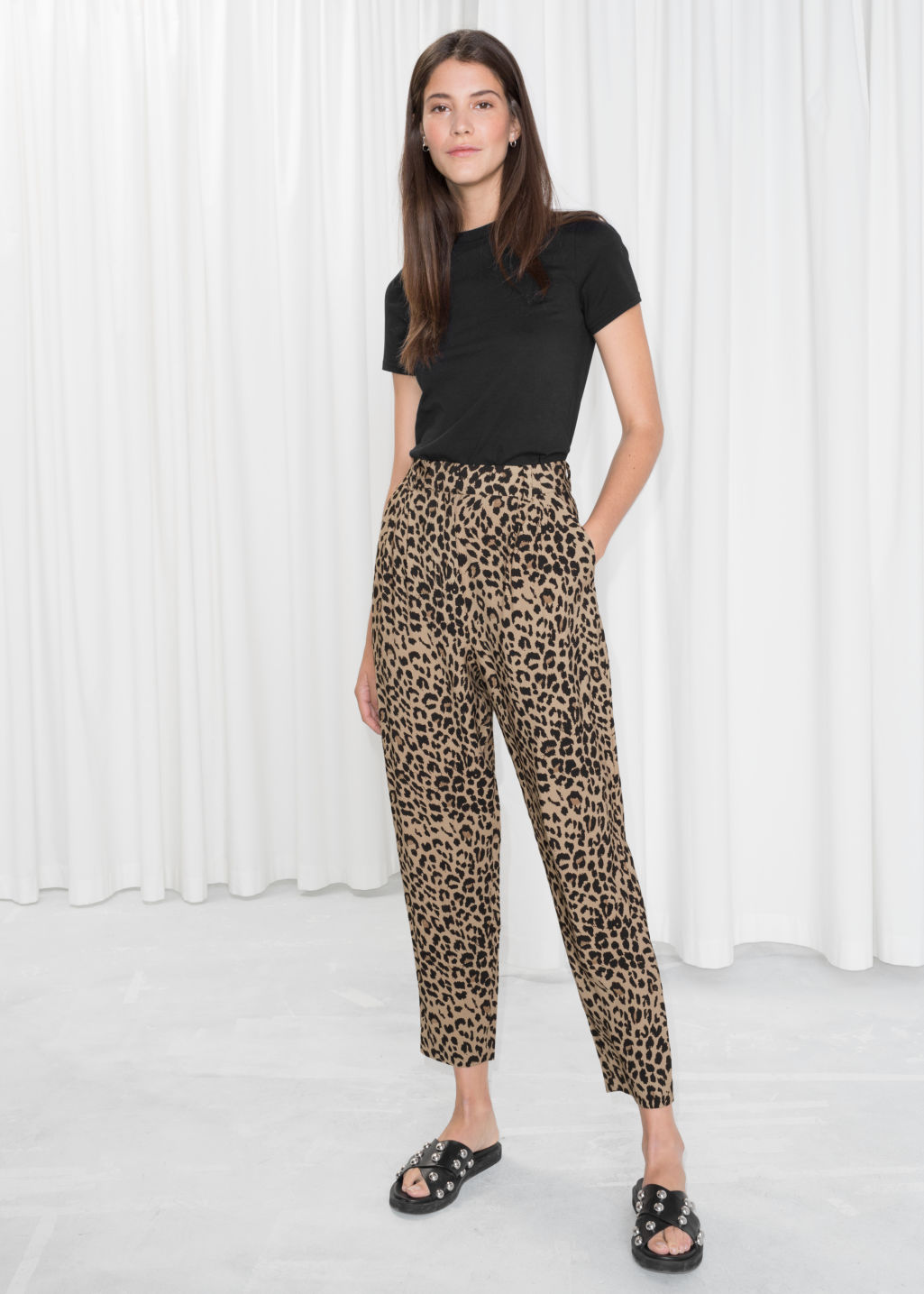 Model front image of Stories printed tapered trousers in black