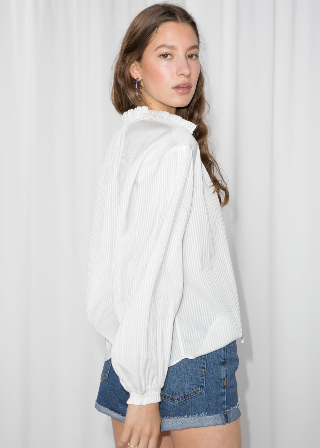 Model back image of Stories billowy tie neck blouse  in white