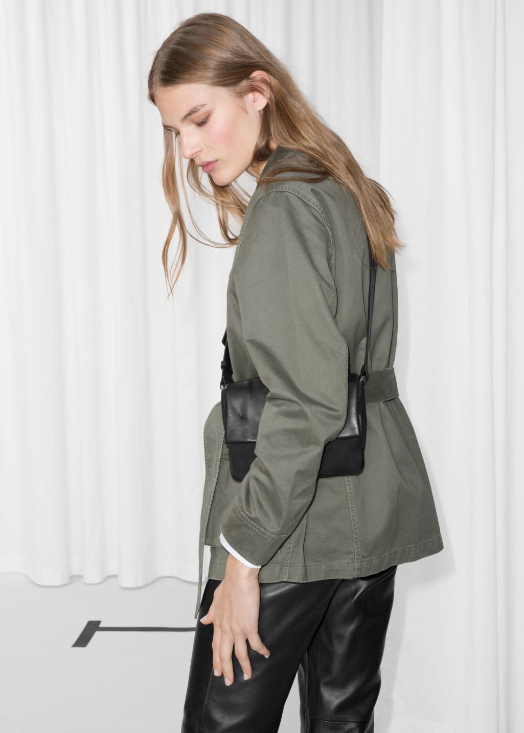 Model back image of Stories belted army jacket in green