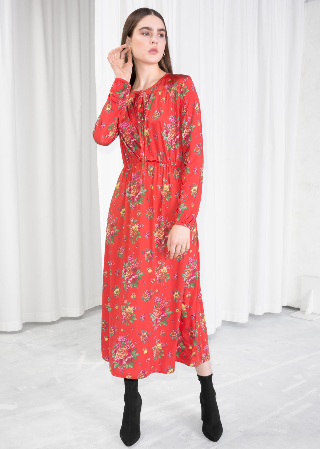 Model front image of Stories printed ruched midi dress in red