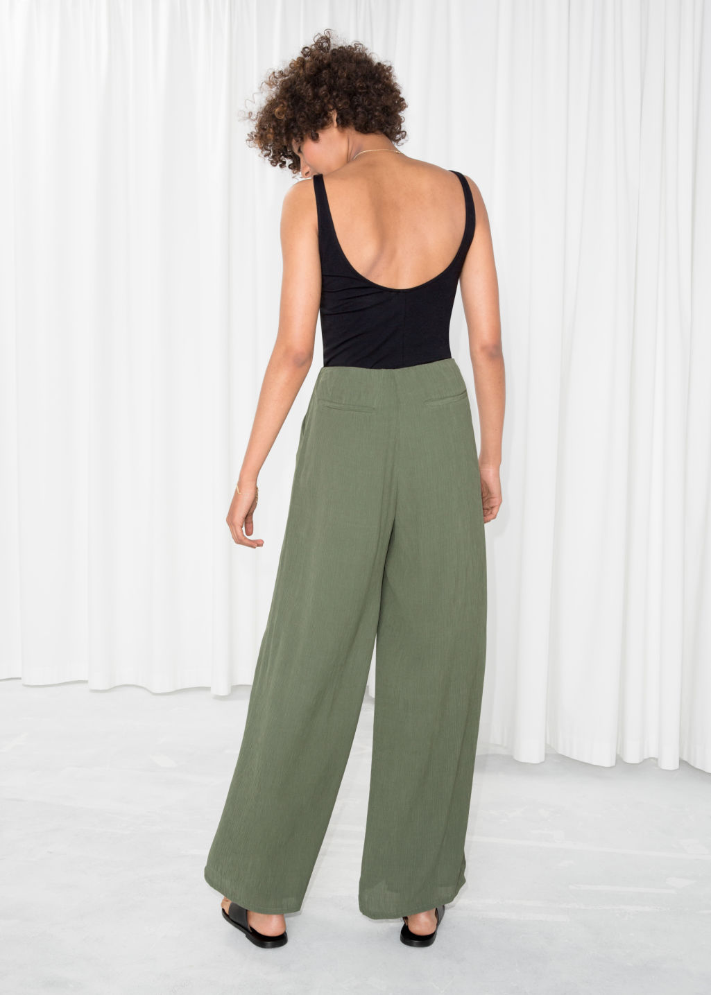 Model back image of Stories wide crepe trousers in green