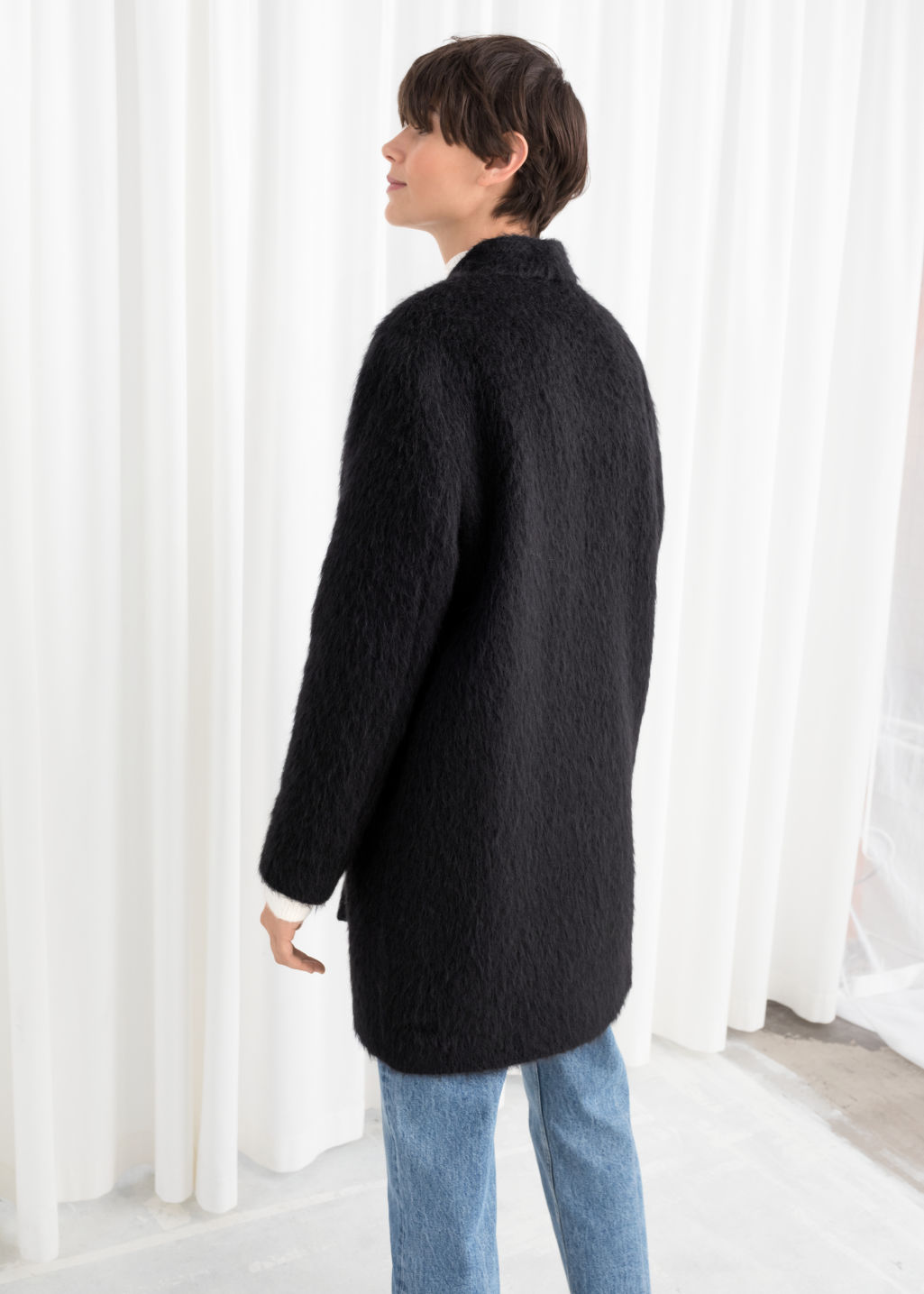 Model back image of Stories boxy coat in black