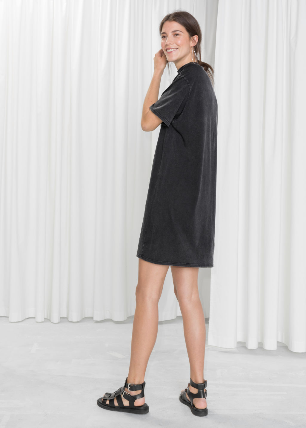 Model back image of Stories mock neck shirt dress in black