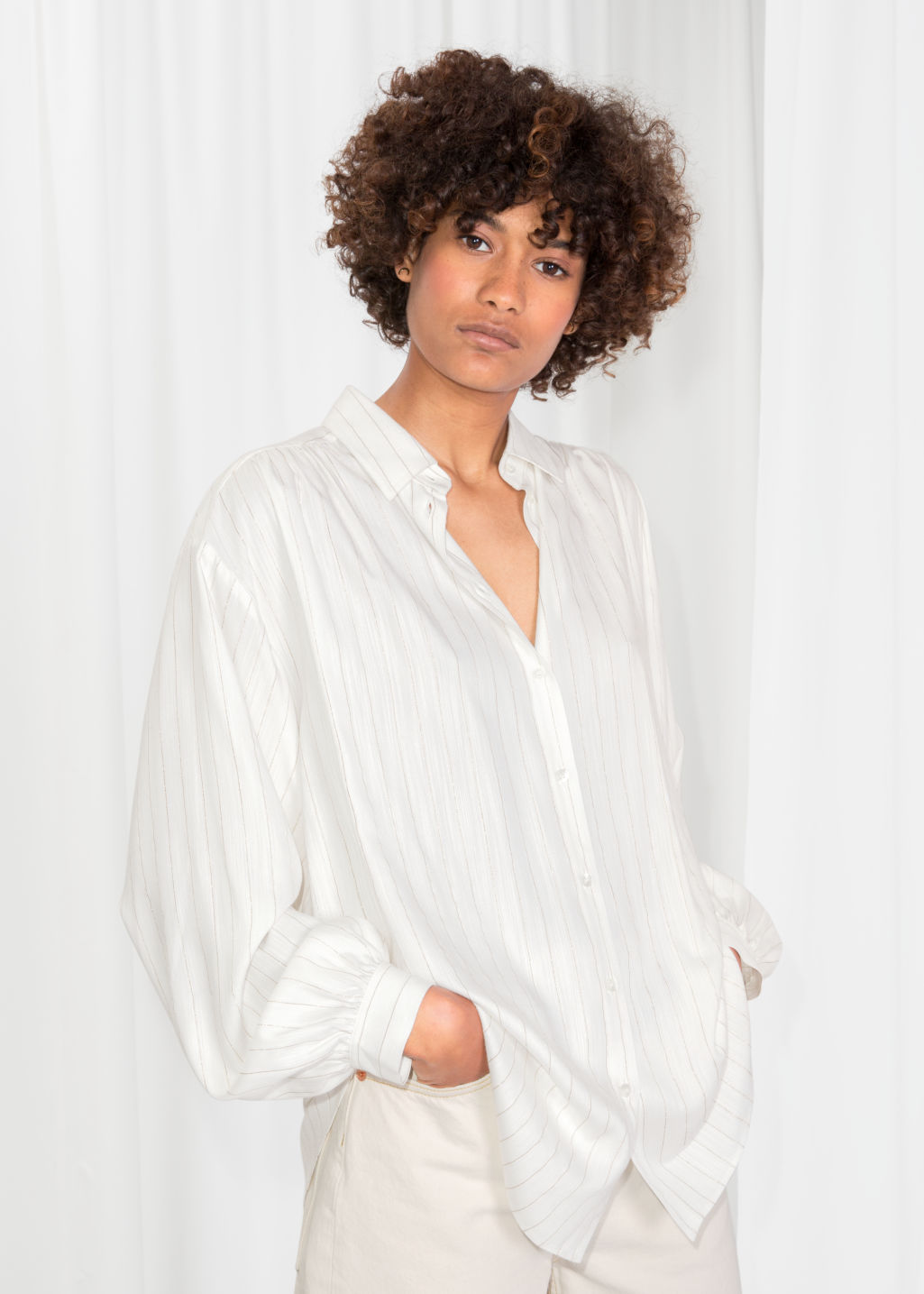 Model front image of Stories oversized billowy shirt in white