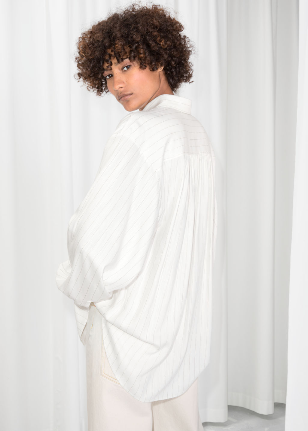 Model back image of Stories oversized billowy shirt in white