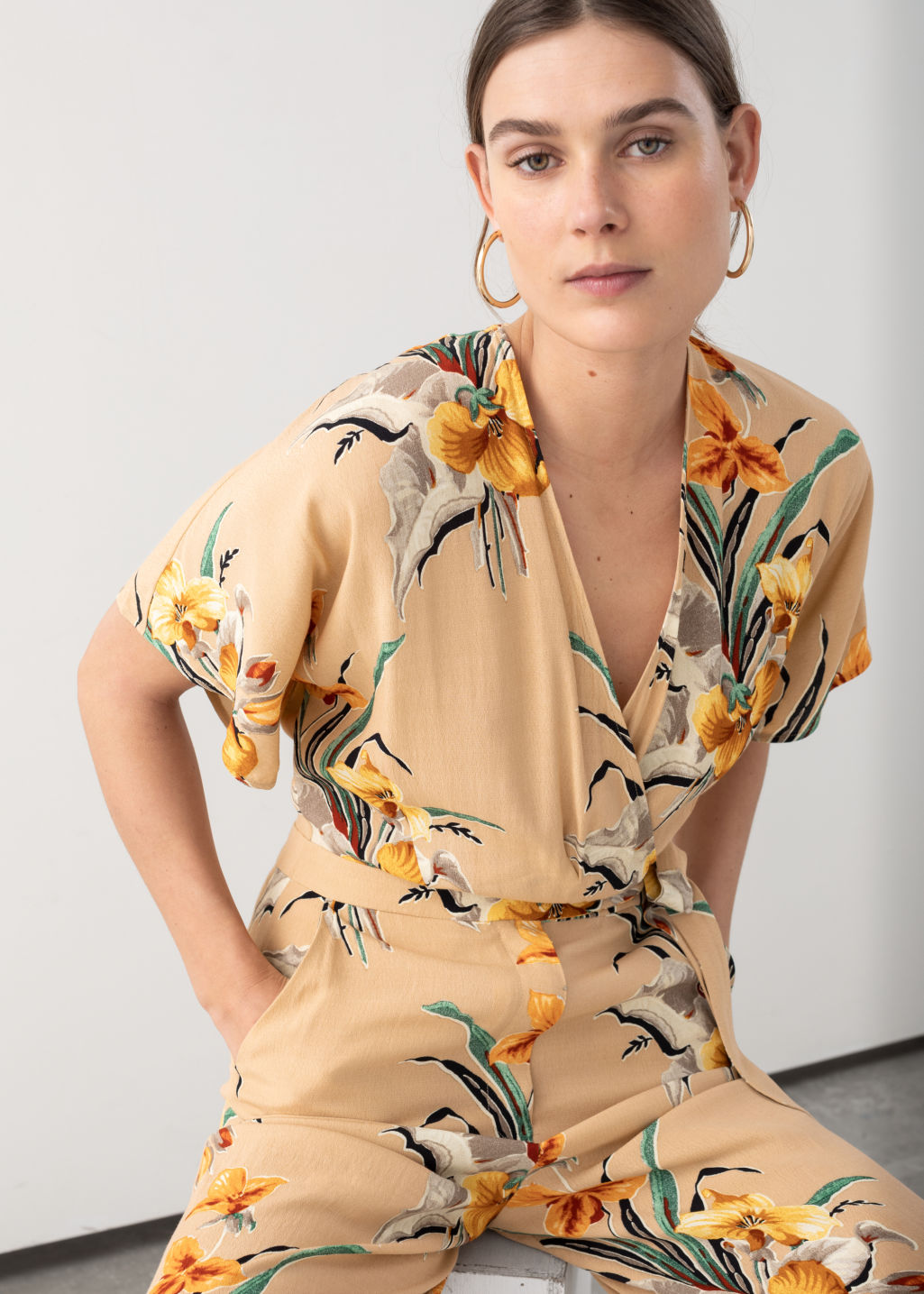 Model front image of Stories tropical print wrap jumpsuit  in beige