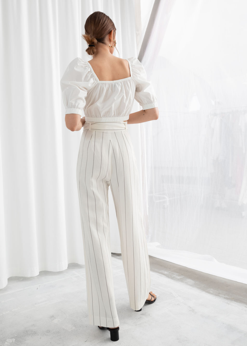 Model back image of Stories paperwaist striped trousers in white