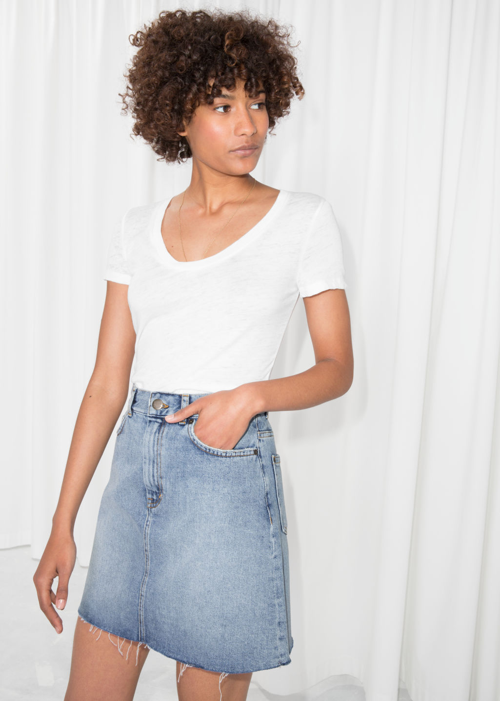 Model front image of Stories raw edge denim skirt  in blue