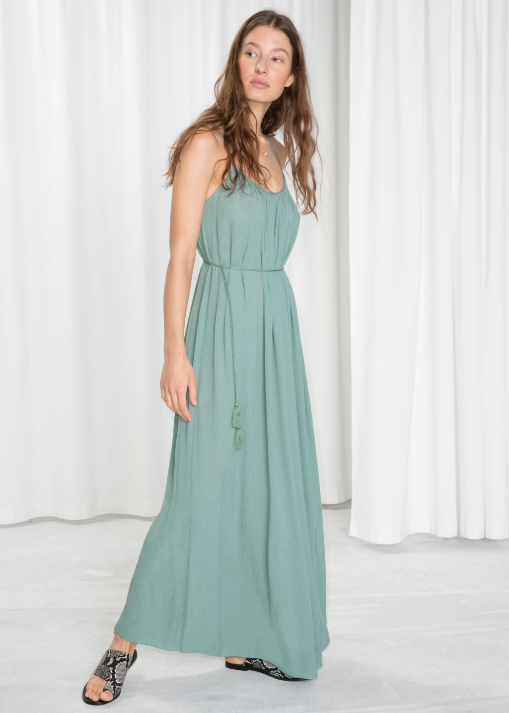 Model front image of Stories flowy belted maxi dress in turquoise