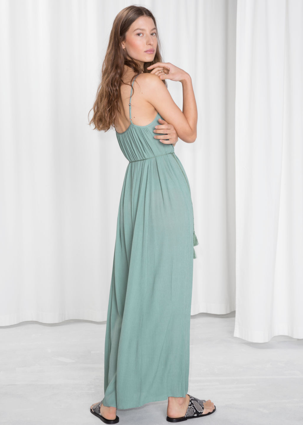 Model back image of Stories flowy belted maxi dress in turquoise