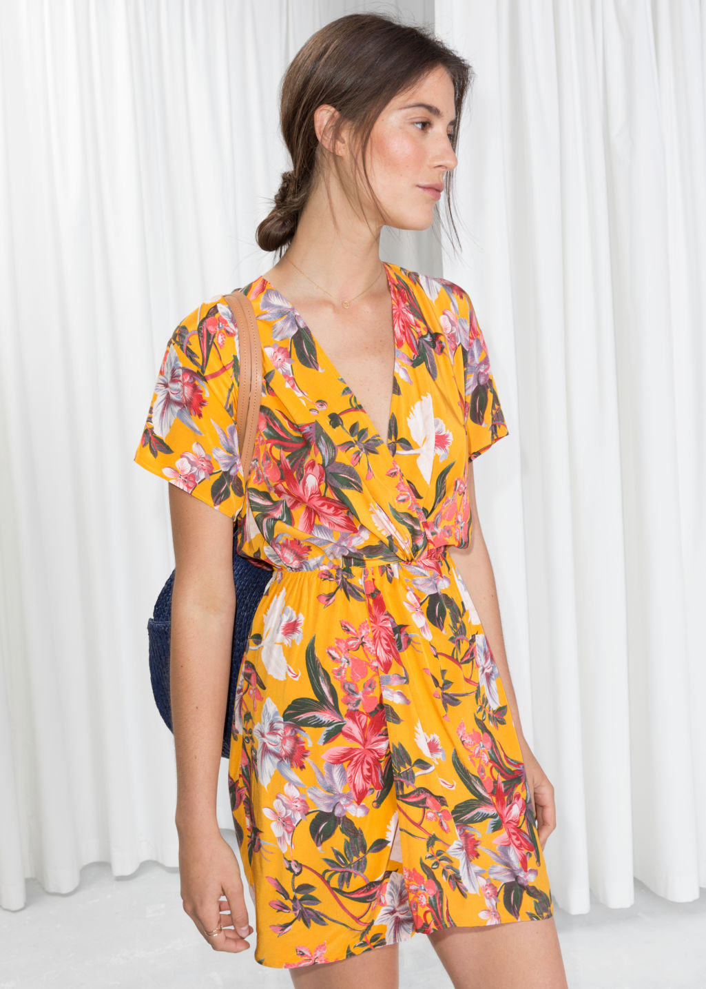 Model front image of Stories printed twist knot dress in yellow