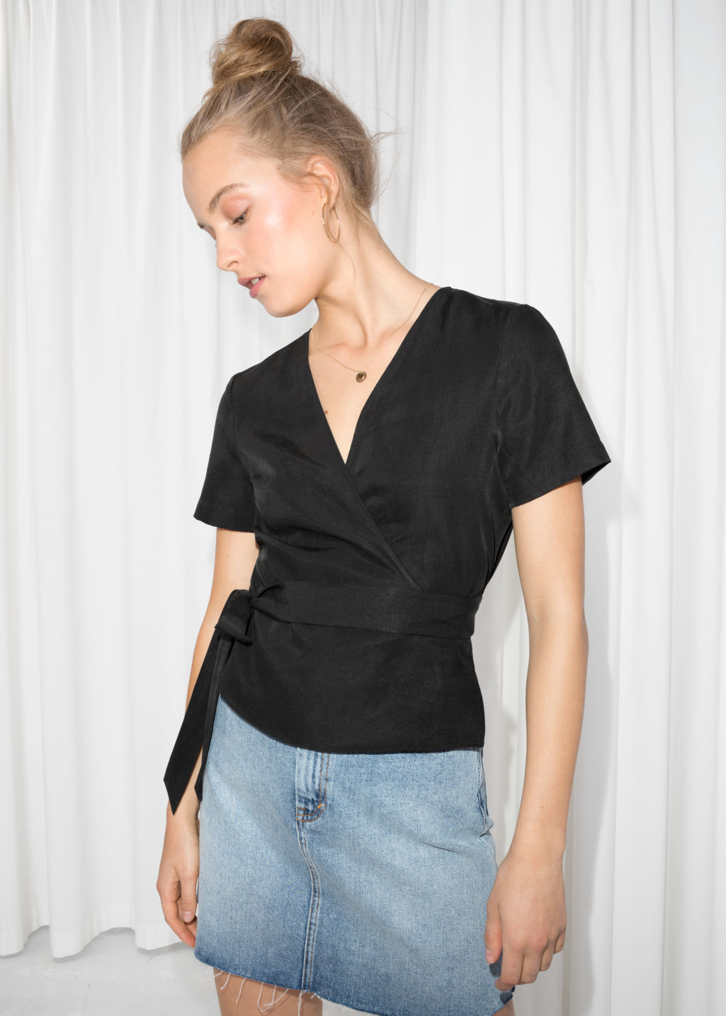 Model front image of Stories wrap tie blouse  in black