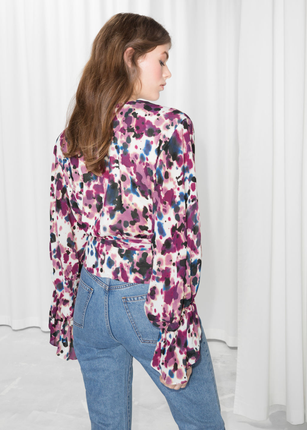 Model back image of Stories bell sleeve wrap blouse  in pink
