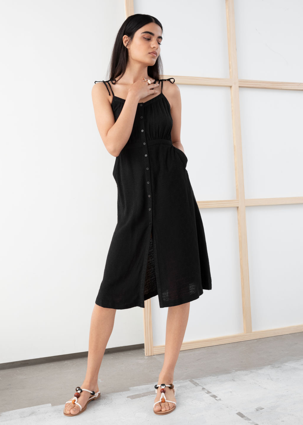 Model front image of Stories printed sundress in black