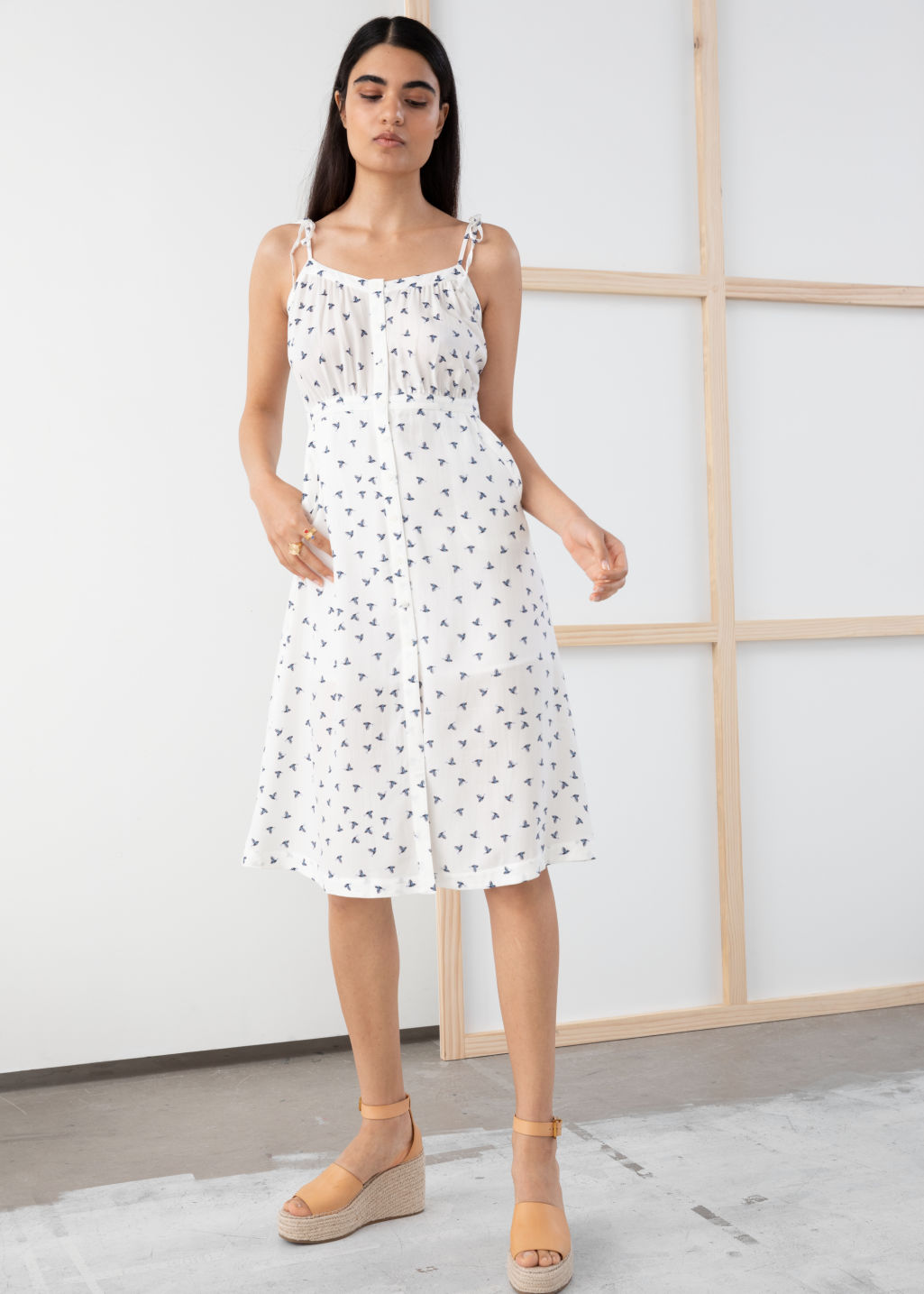 Model front image of Stories printed sundress in white