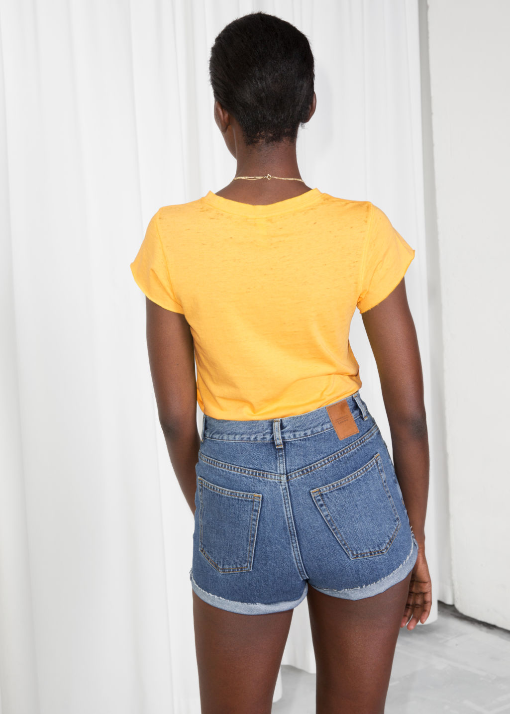 Model back image of Stories  in yellow