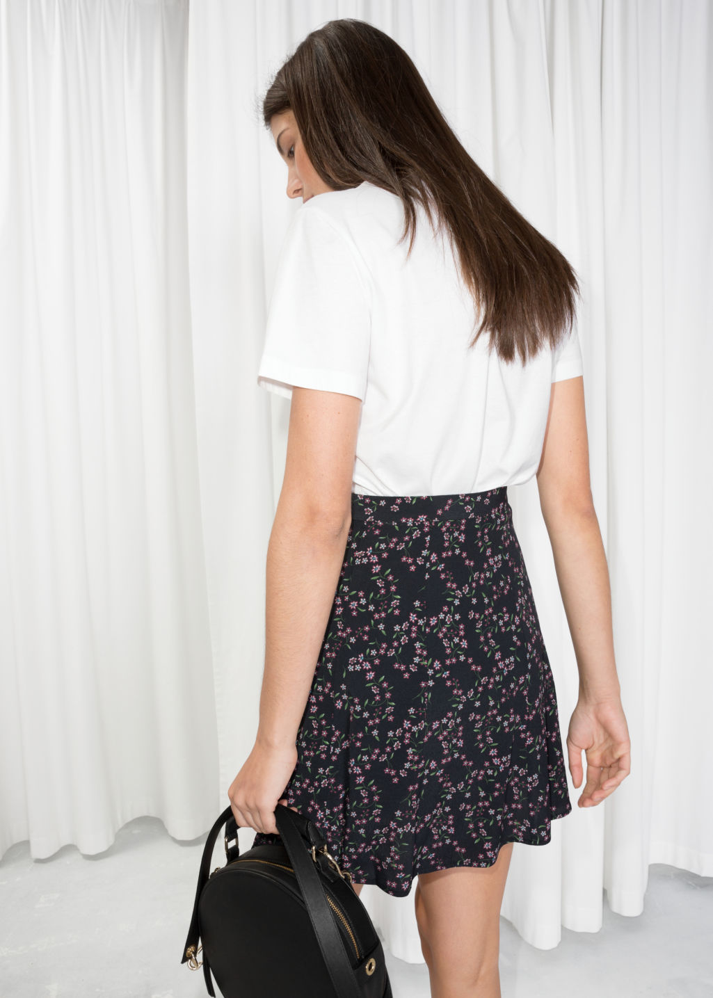 Model back image of Stories floral print circle skirt  in black