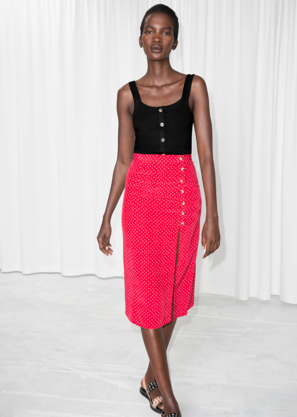Model front image of Stories asymmetrical button midi skirt in red