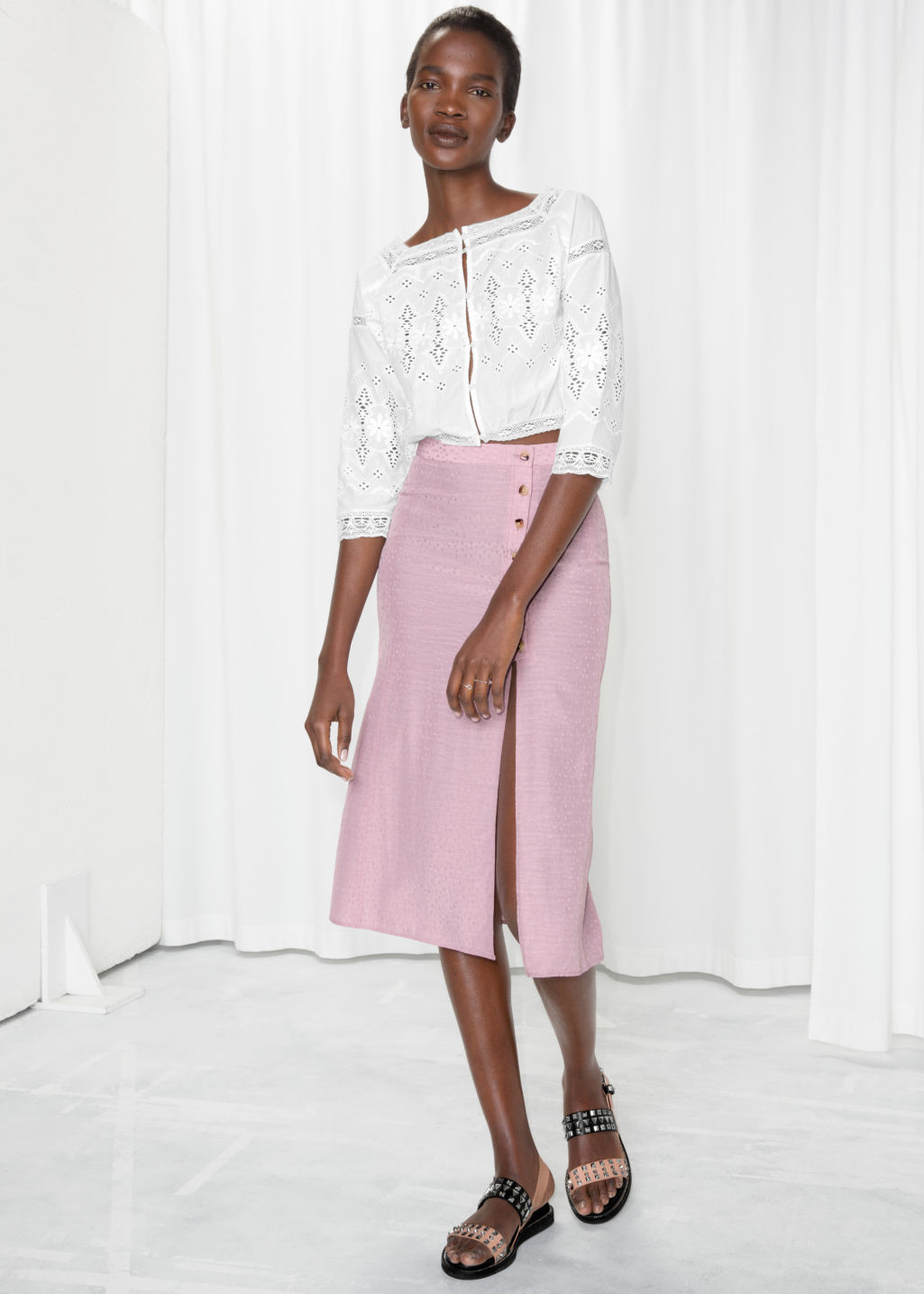 Model front image of Stories asymmetrical button midi skirt in pink