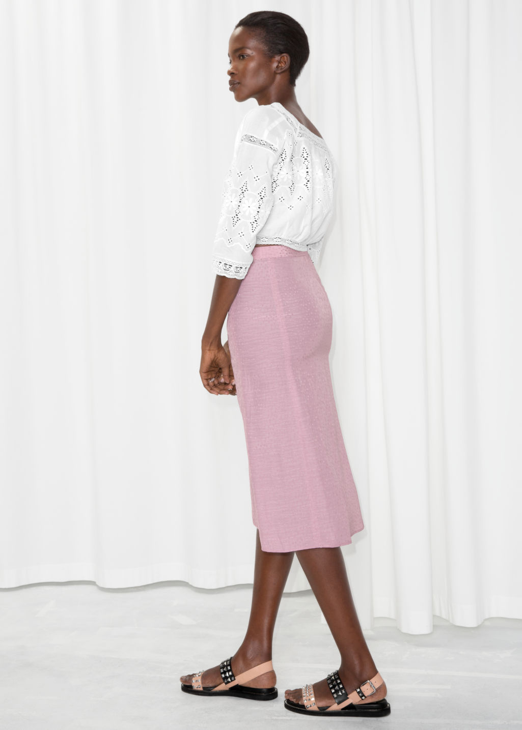 Model back image of Stories asymmetrical button midi skirt in pink