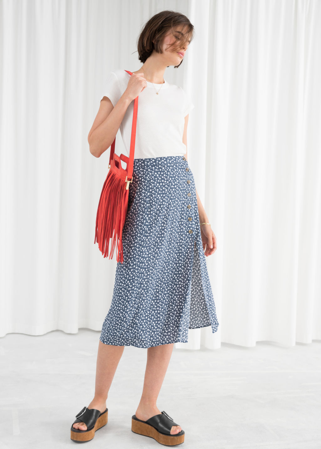 Model front image of Stories asymmetrical button midi skirt in blue