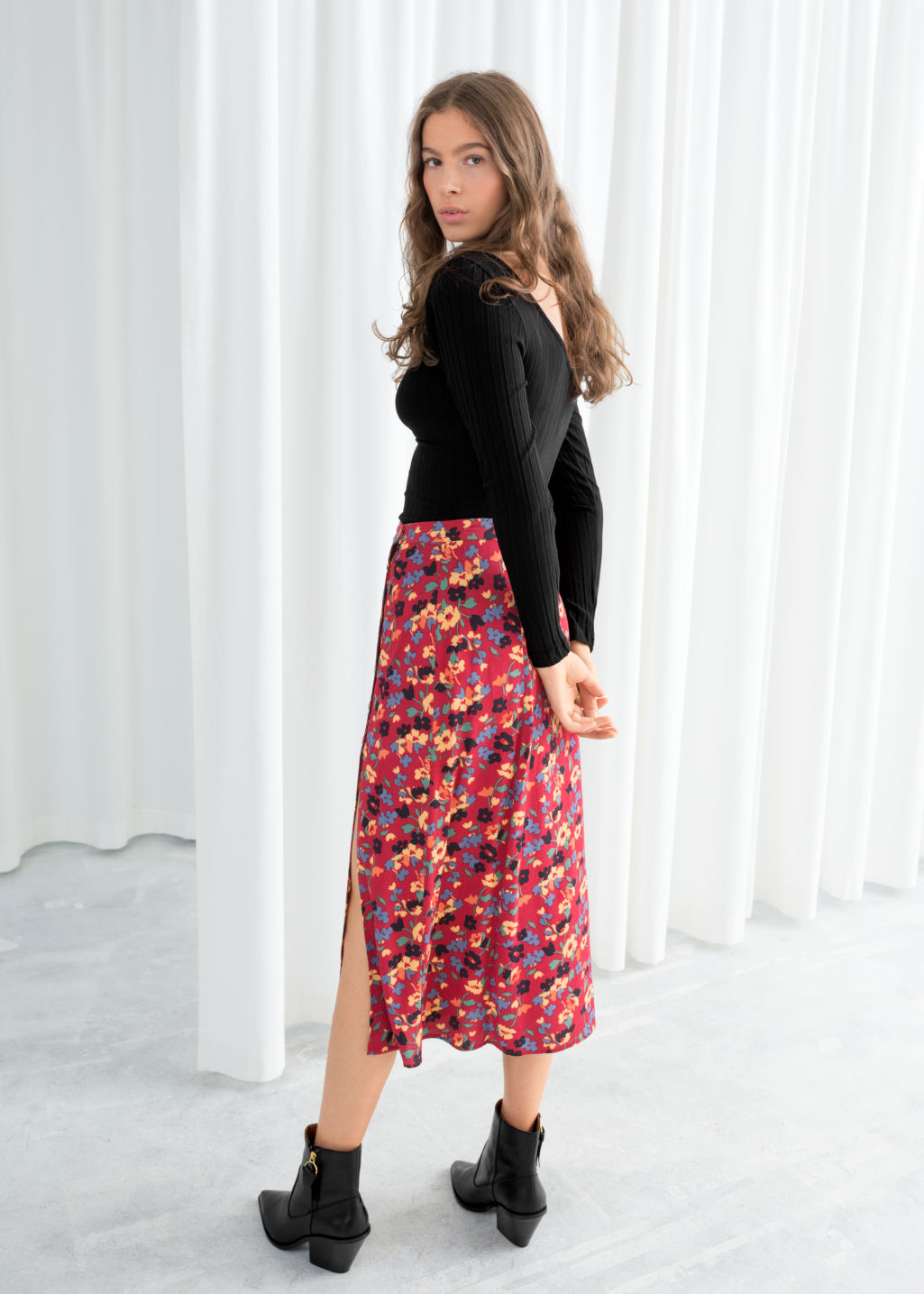 Model back image of Stories asymmetrical button midi skirt in red