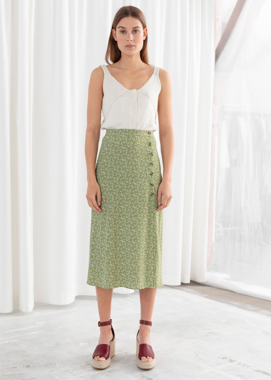 Model front image of Stories asymmetrical button midi skirt in green