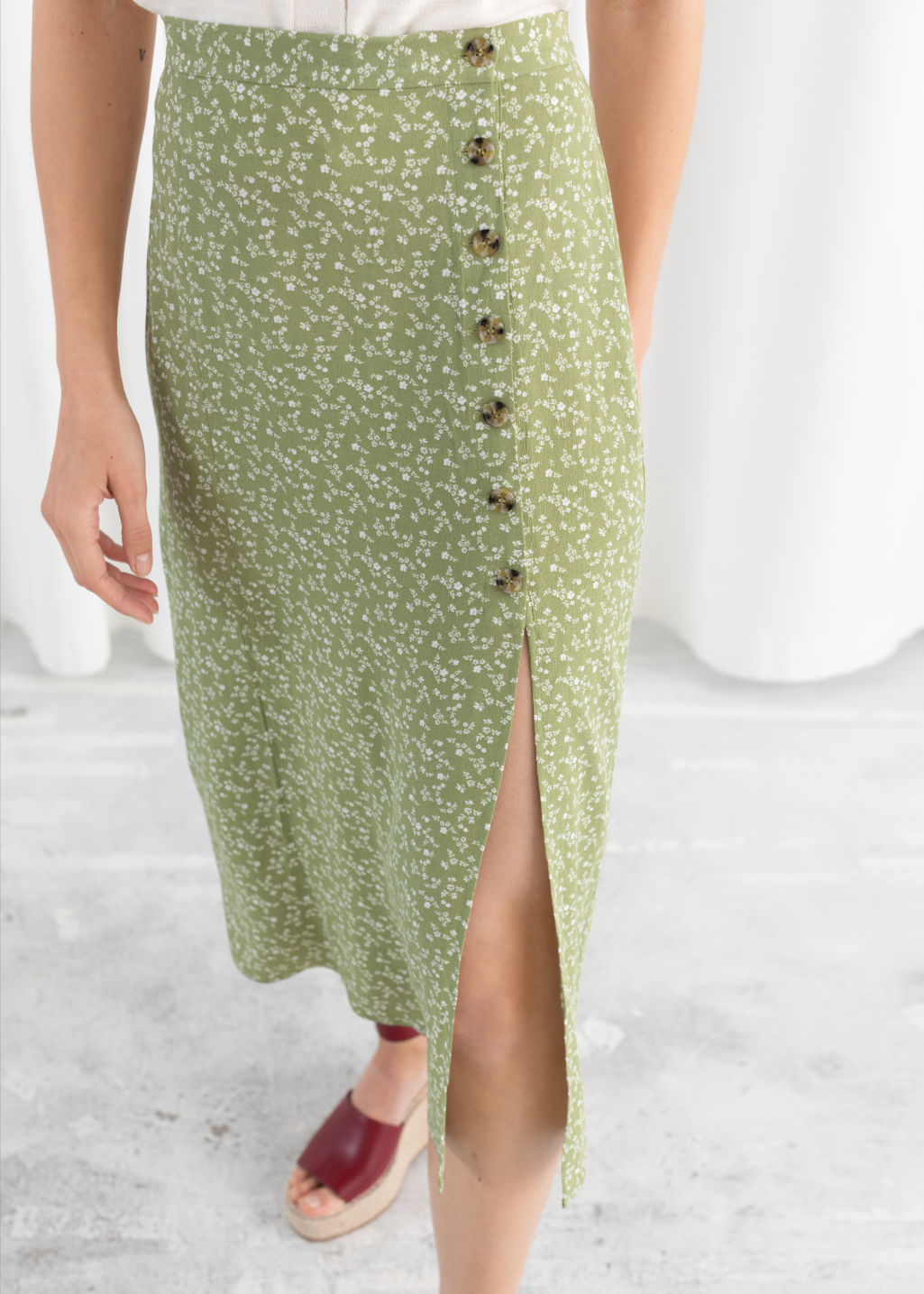 Model back image of Stories asymmetrical button midi skirt in green