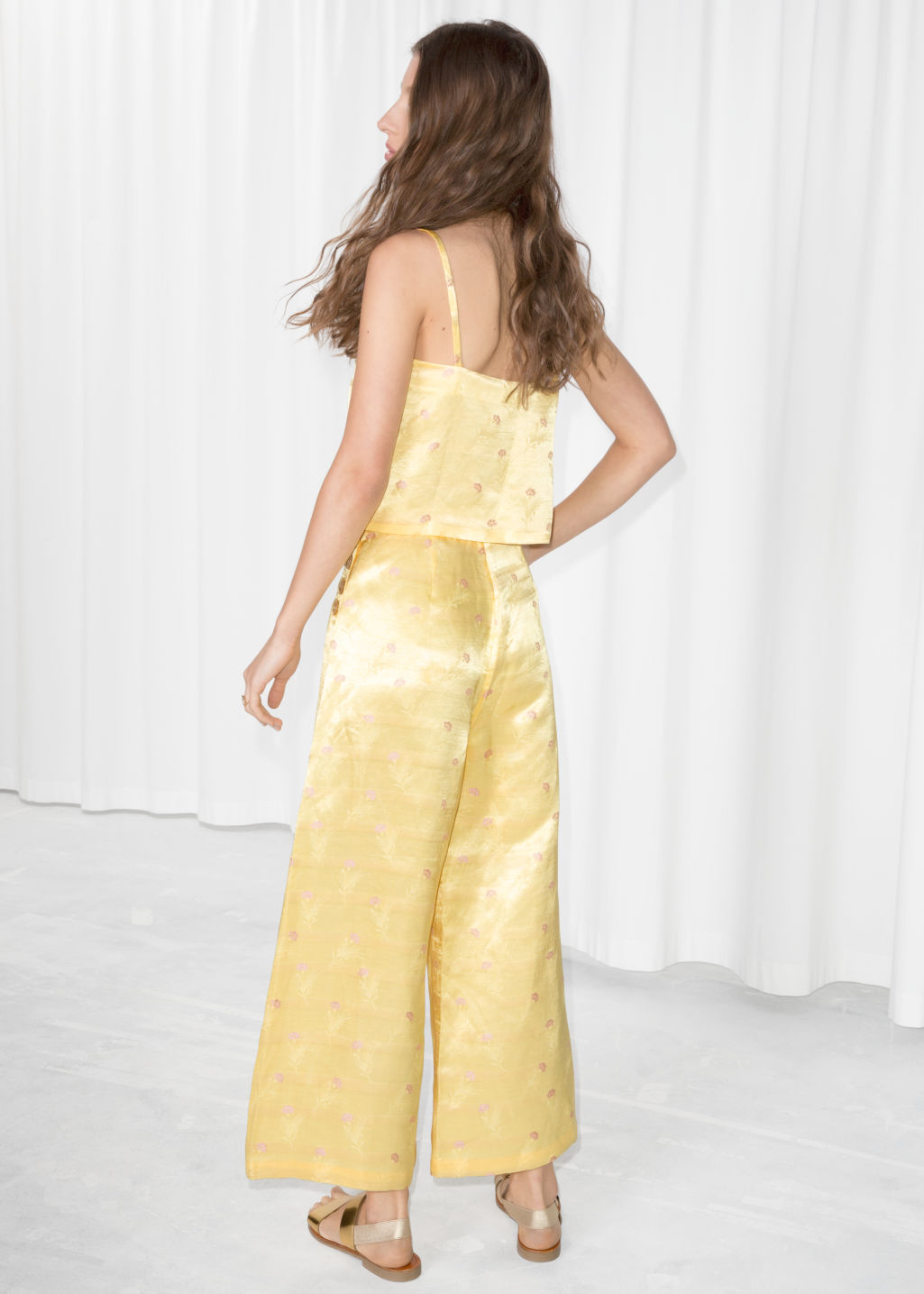 Model back image of Stories floral satin wide trousers in yellow