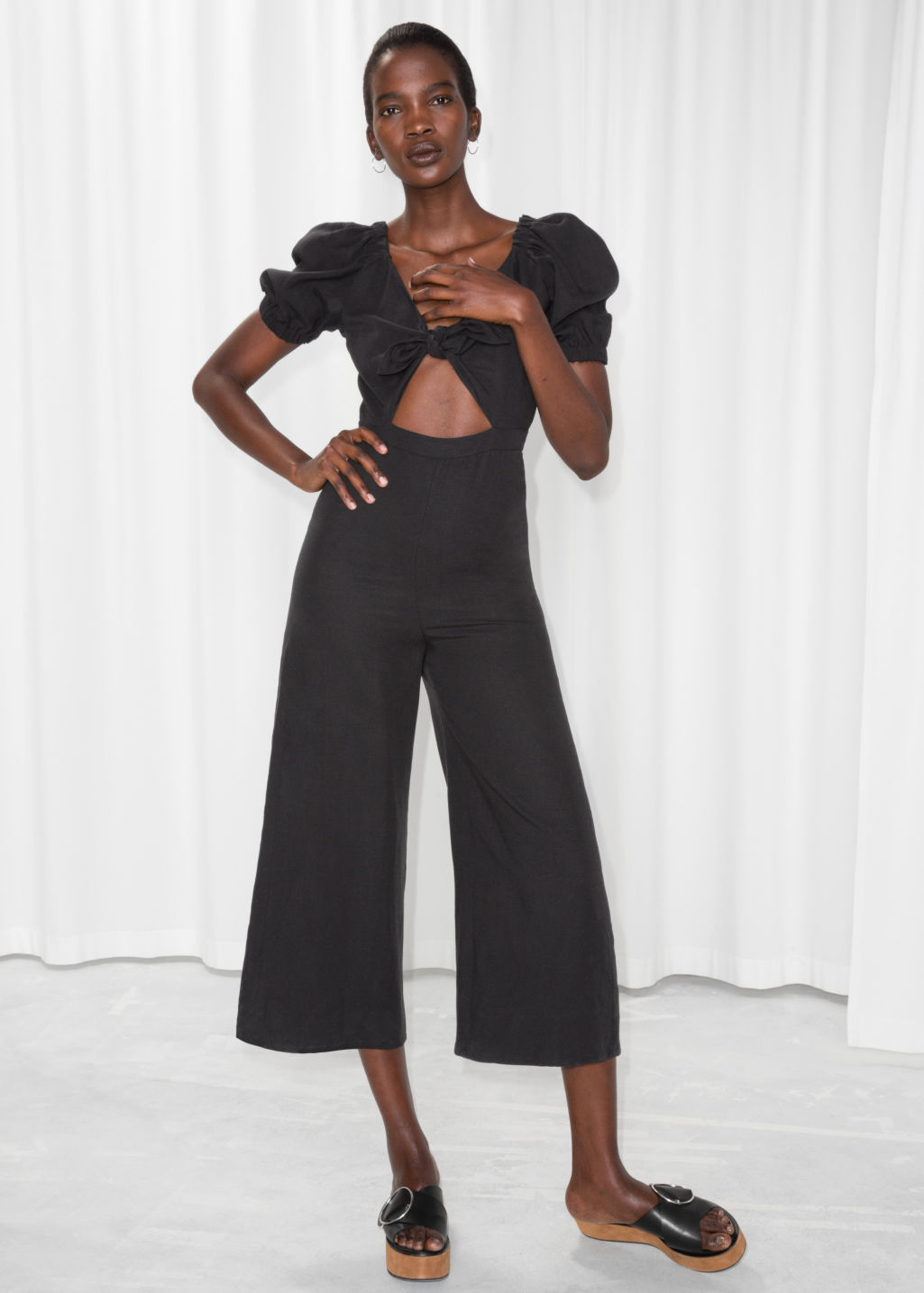 Model front image of Stories knotted cutout jumpsuit in black