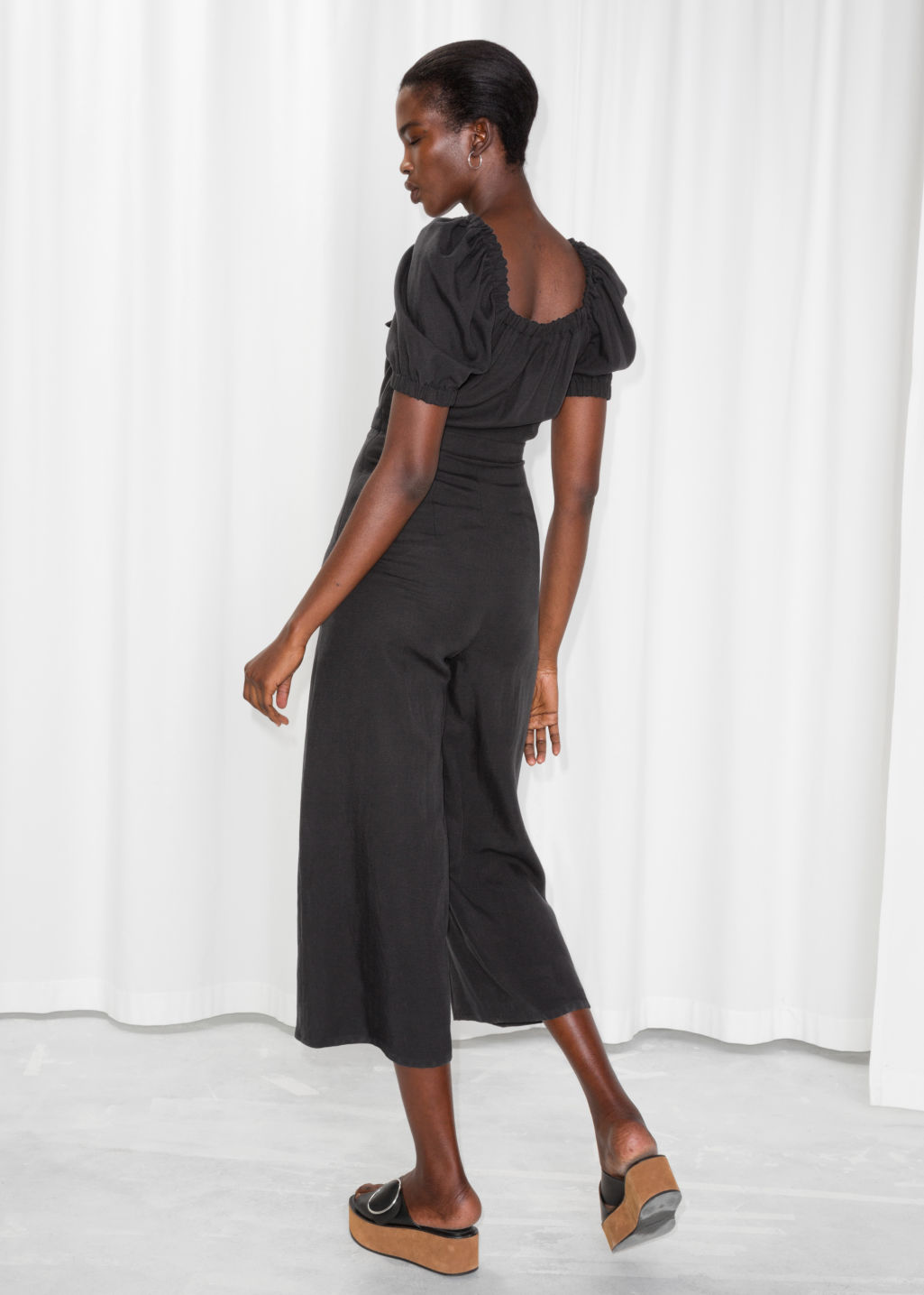 Model back image of Stories knotted cutout jumpsuit in black