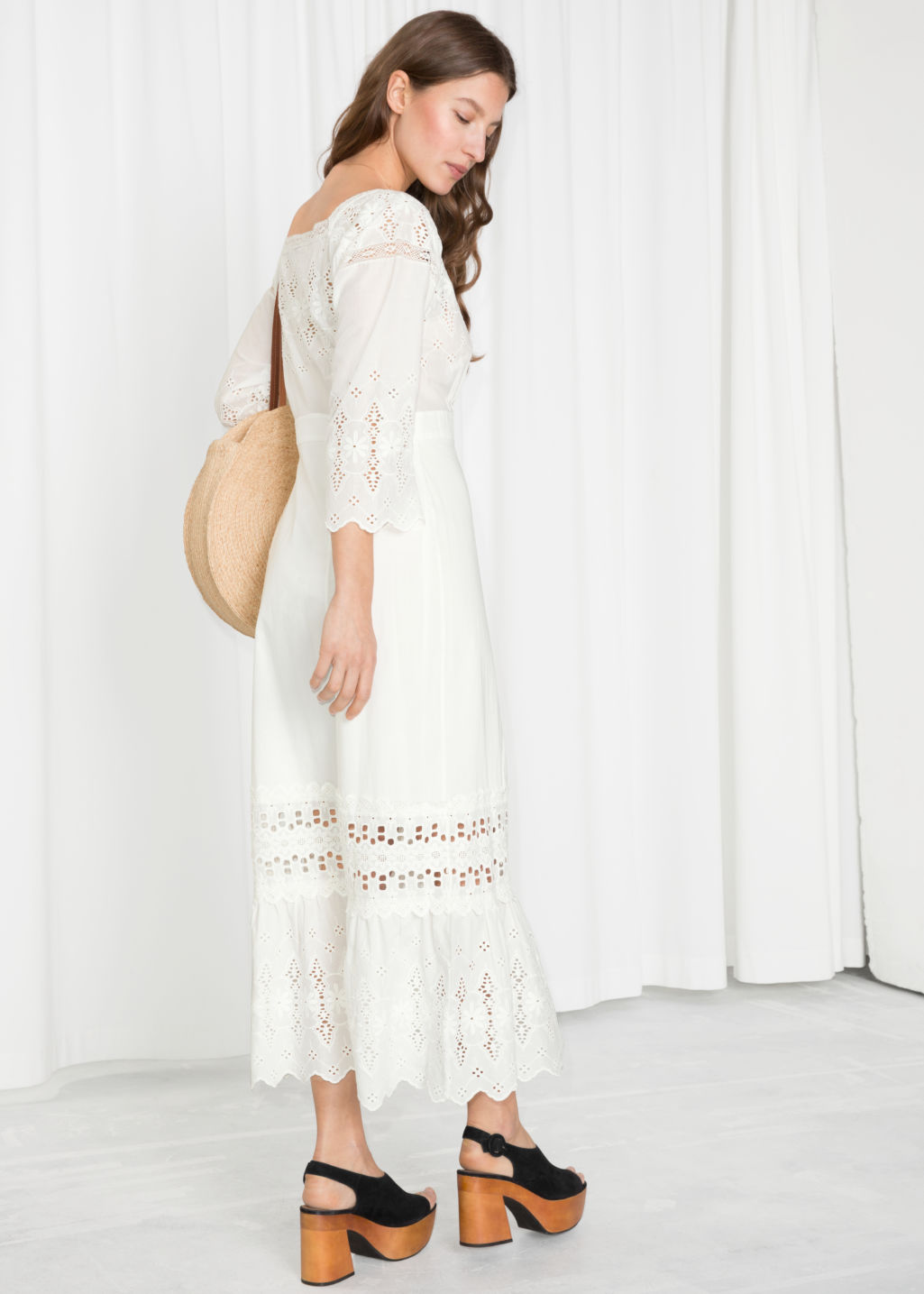 Model front image of Stories eyelet midi dress in white