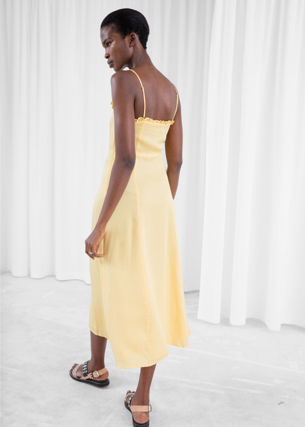 Model back image of Stories ruffled lace up maxi sundress in yellow