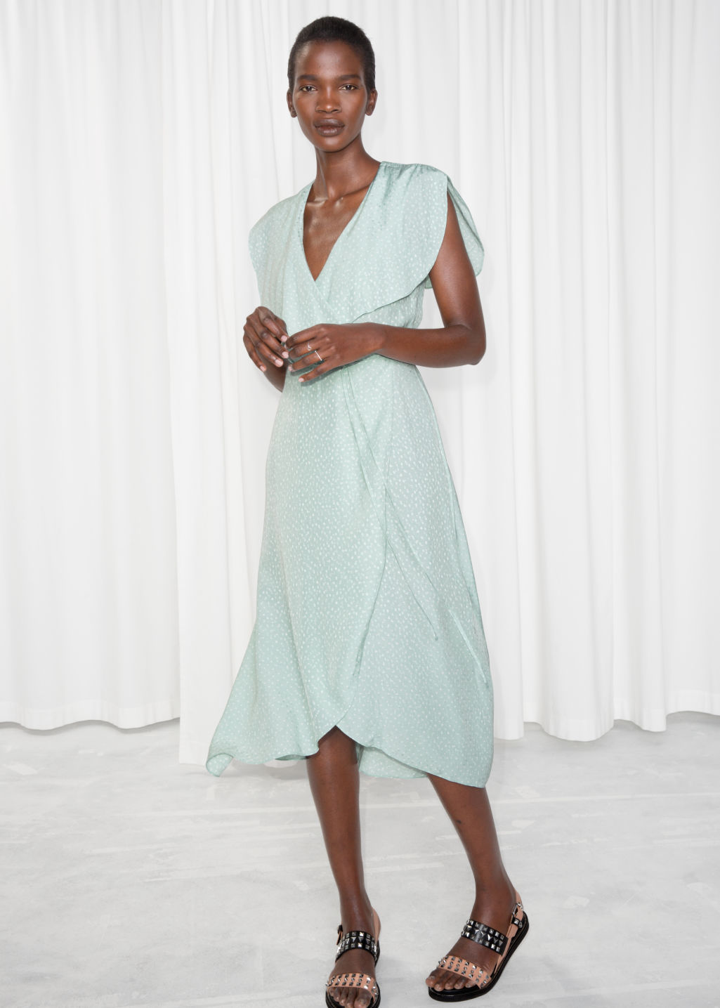 Model front image of Stories oversized lapel wrap dress in turquoise