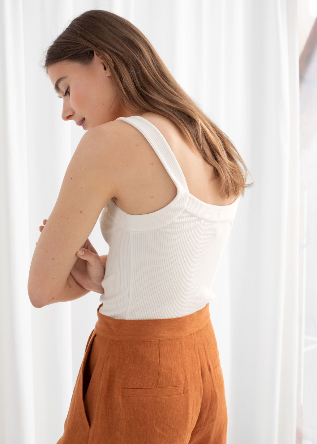 Model back image of Stories ribbed tank top  in white