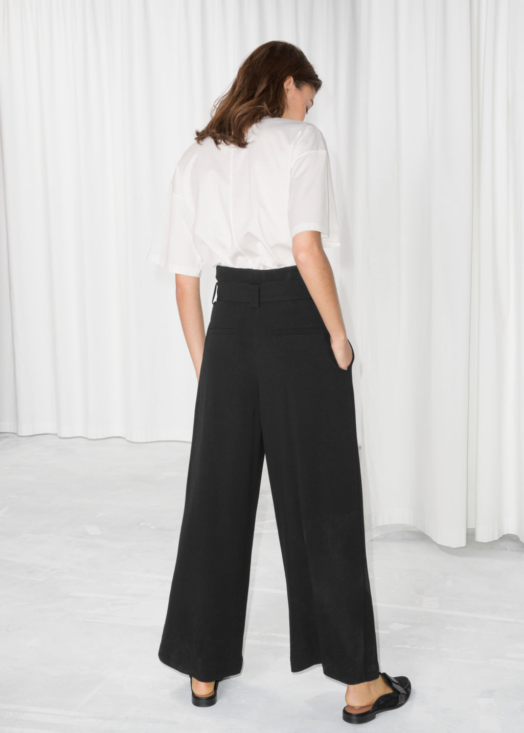 Model back image of Stories belted wide trousers in black
