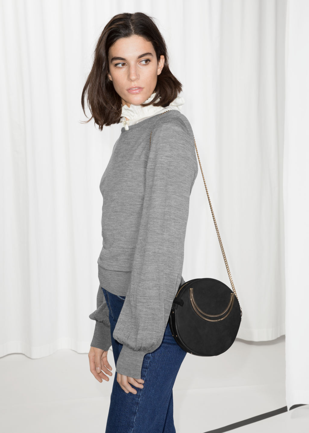 Model front image of Stories billow sleeve sweater in grey