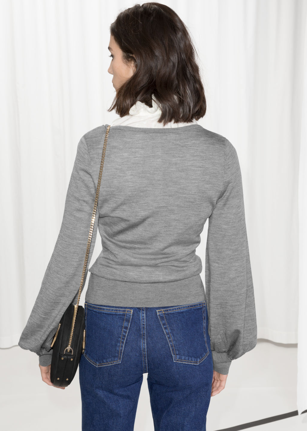 Model back image of Stories billow sleeve sweater in grey