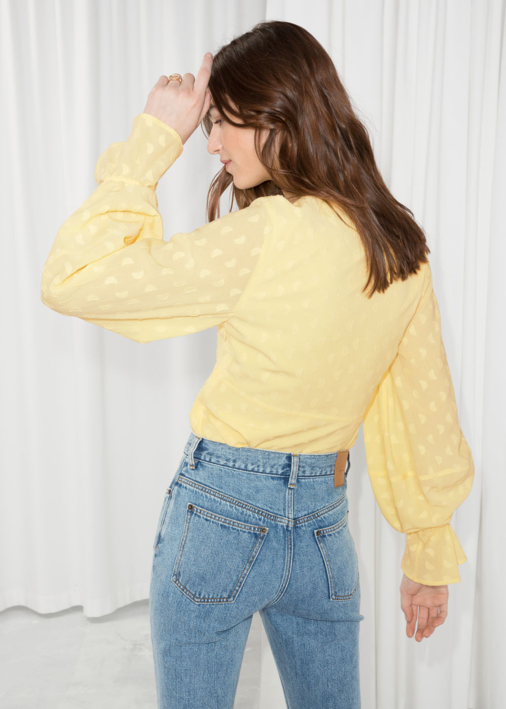 Model back image of Stories plunging jacquard blouse  in yellow
