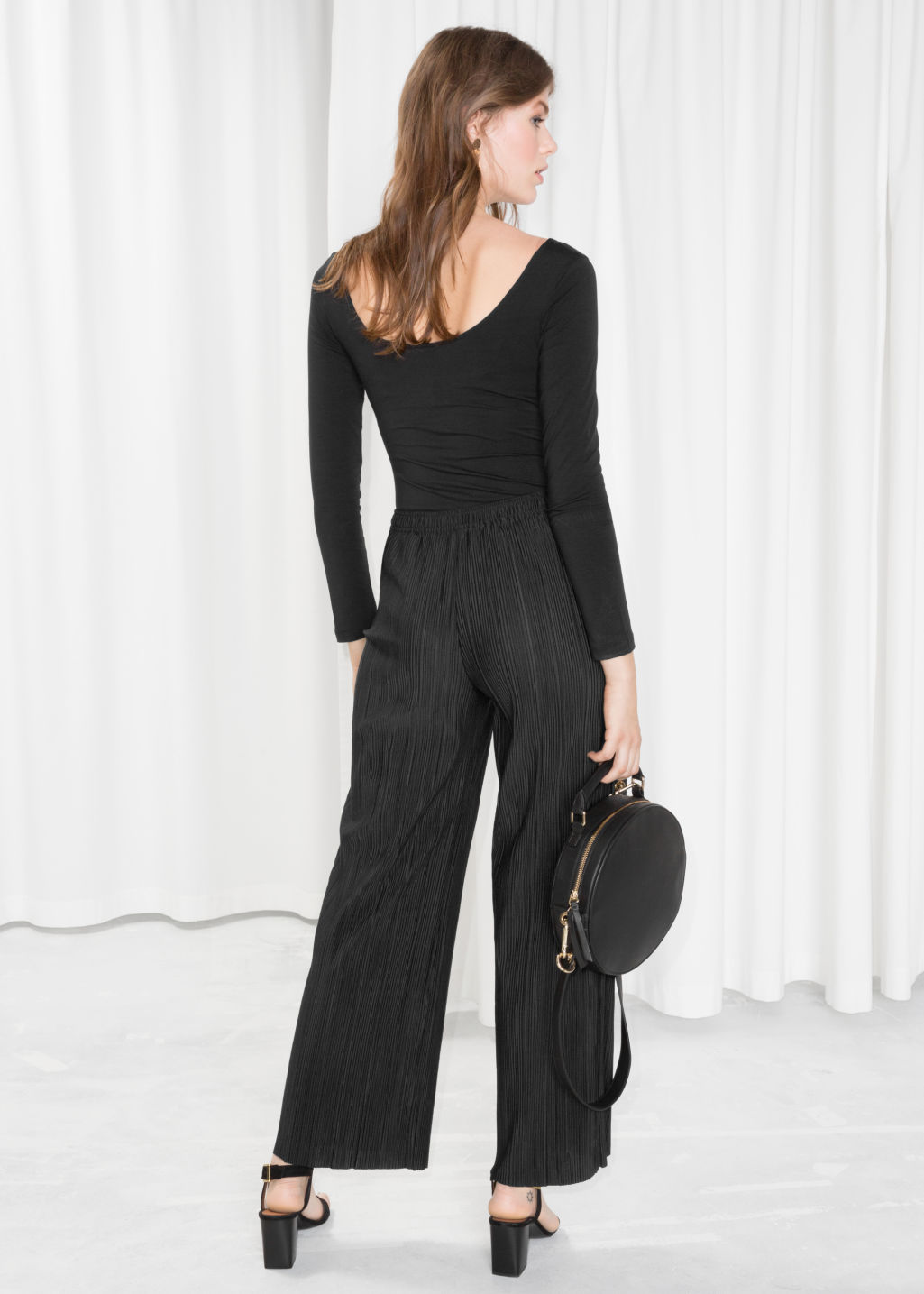 Model back image of Stories high waisted pleated trousers in black