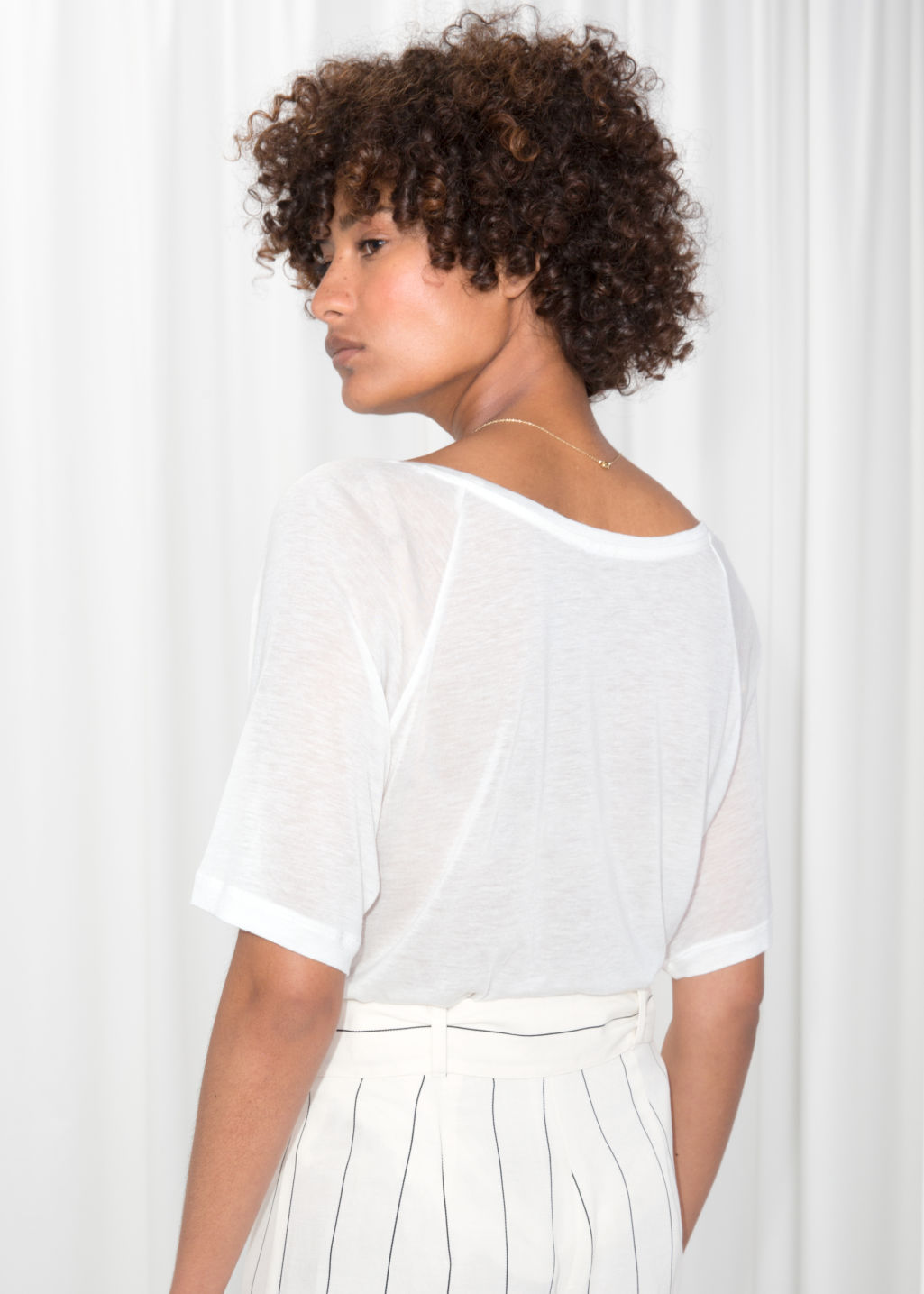 Model back image of Stories raglan sleeve tee in white