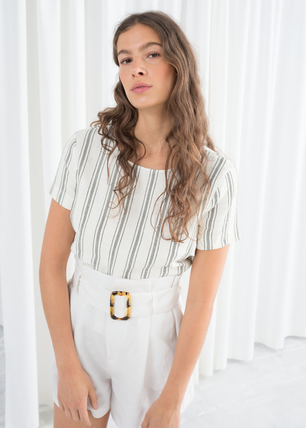 Model front image of Stories striped linen top in white