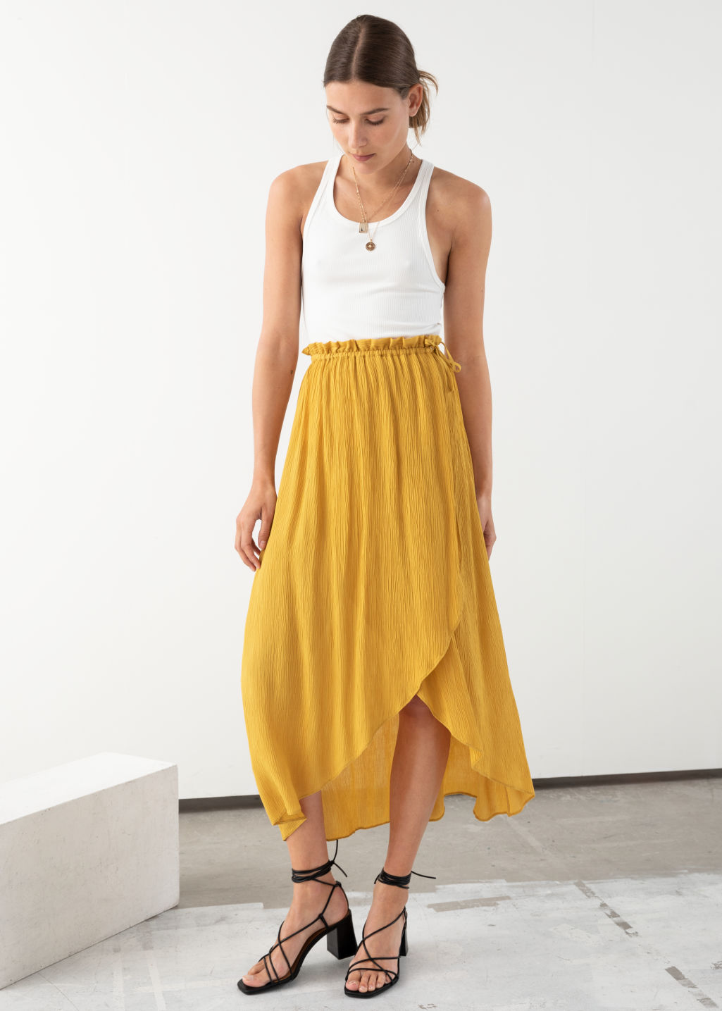 Model front image of Stories paperbag waist wrap skirt in yellow