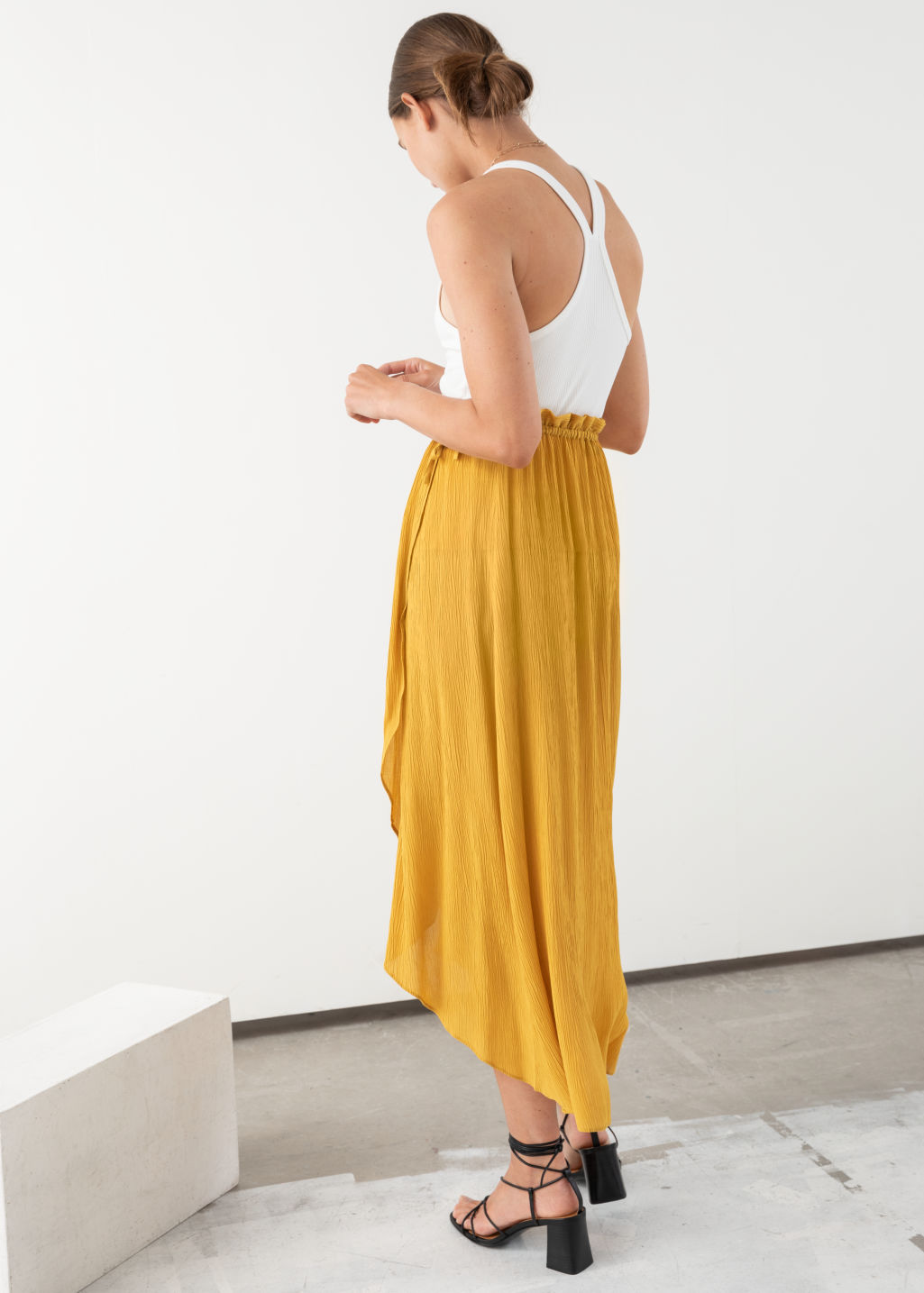 Model back image of Stories paperbag waist wrap skirt in yellow