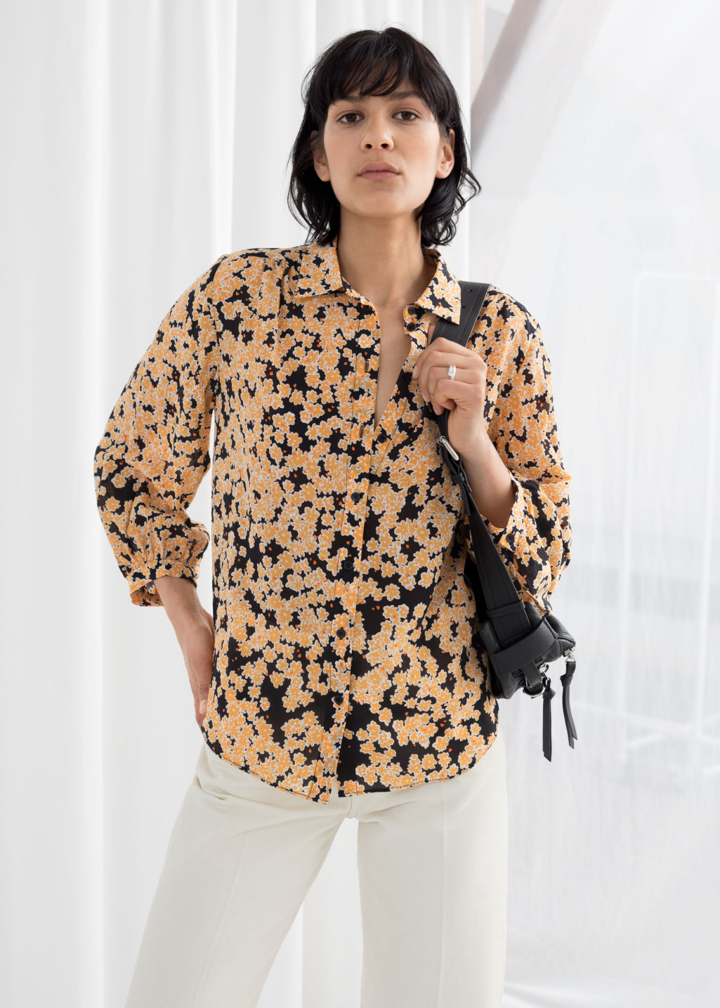 Model front image of Stories printed silk button up  in yellow
