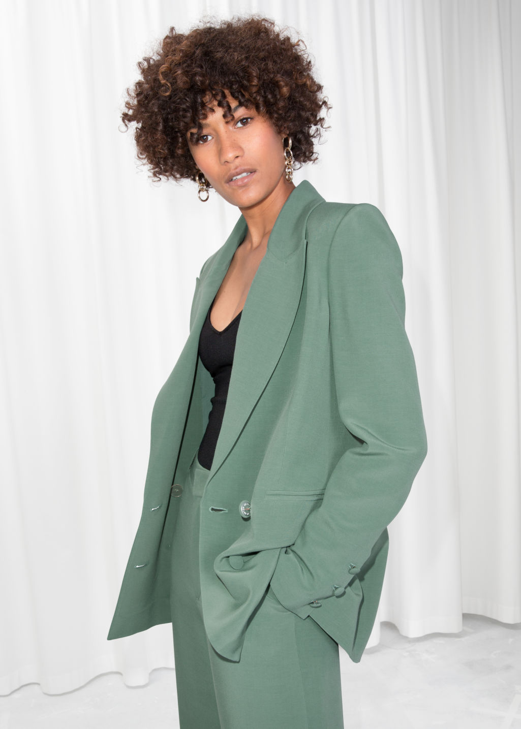 Model front image of Stories oversized long blazer in green