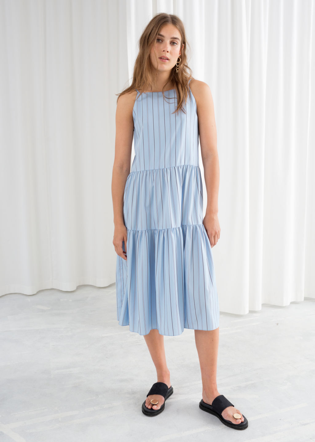 Model front image of Stories gathered pleated midi dress in blue